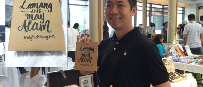 Manny Viloria holding notebook with calligraphy of Pat Diosana